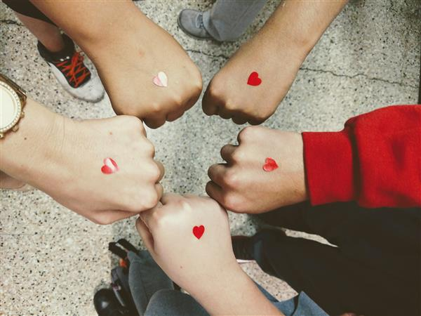 Students brought together wearing hearts in support of Violence Awareness Week.